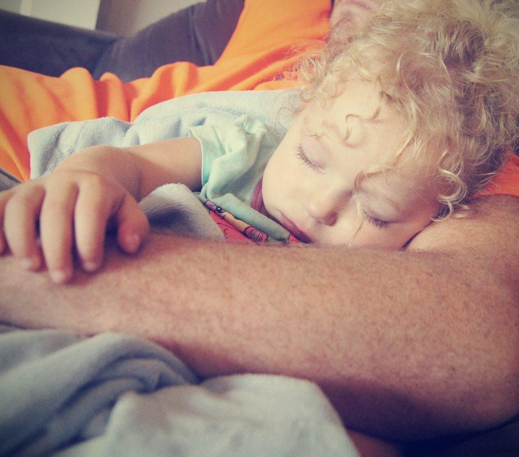 baby sleep dad's arms